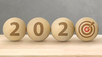 wood balls with the numbers 2-0-2-0