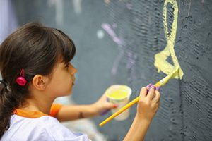 a child painting a wall