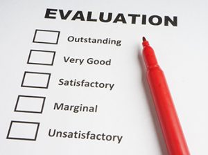 """Paper and marker; paper has """"evaluation"""" written at the top with a checklist beneath"""