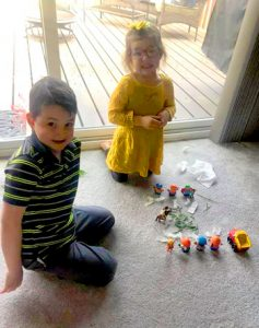 two and three year old with small toys