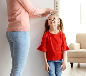 Little girl having her height measured