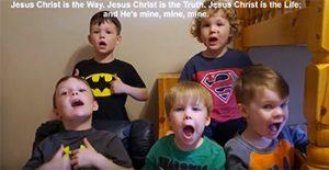 Plonk boys singing; words on screen