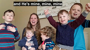 """Michelle Plonk and boys singing """"He's mine, mine, mine"""" about Jesus."""