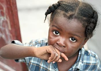 Haitian little girl like many Haitian orphans