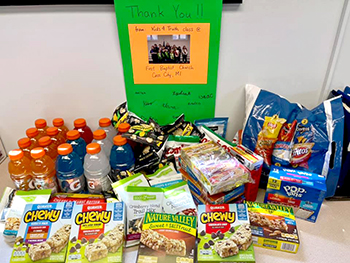 Snacks, etc., and poster for Cass City, MI, PD from Kids4Truth Clubs at 1st Baptist Church