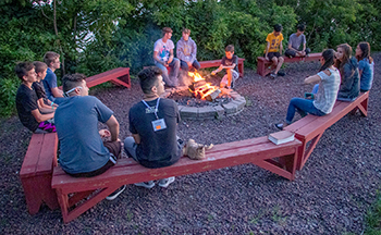 Kids4Truth Clubs kids meet around a campfire for a special event night or competition reward