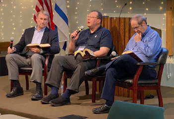 Before preaching on God's forever kingdom, Mike Stallard participates in panel at prophecy conference 8/2021 at Grace Bible Church, Portage, Wis.
